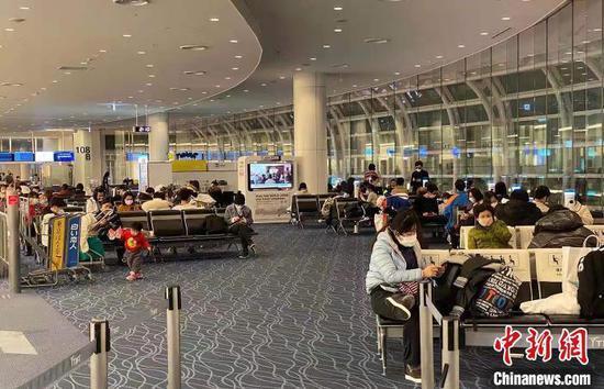 中国包机接回游客 赴日接回111名武汉旅客返乡